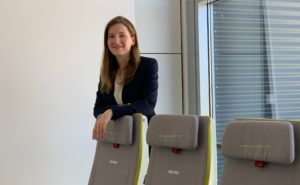 Laura Karbach is pictured standing behind a row of Recaro slimline seats
