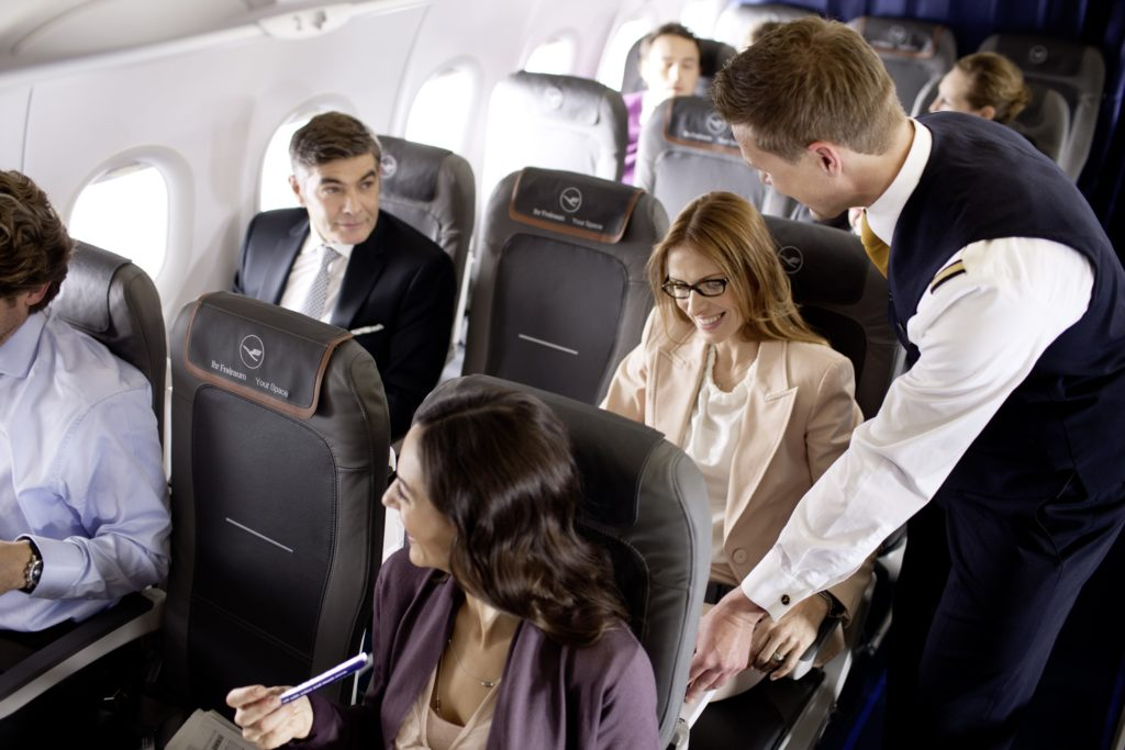 Lufthansa Eurobusiness, with passengers seated in window and aisle seats and the middle seat left open