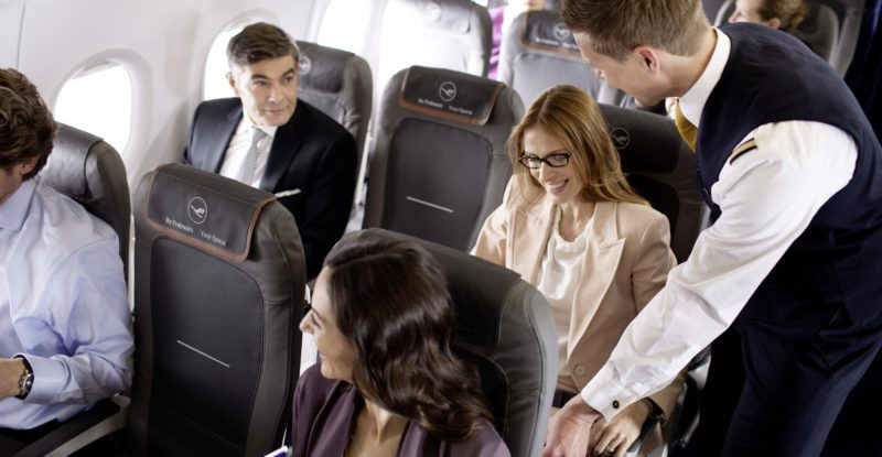 Lufthansa passengers being served onboard