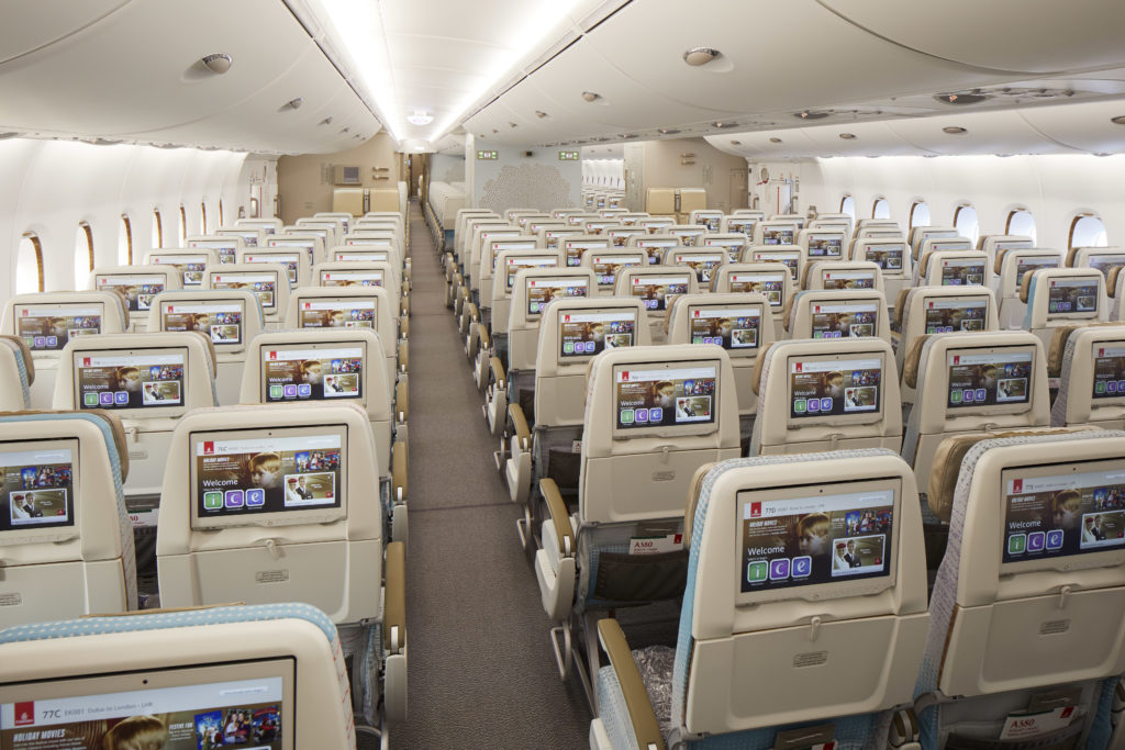 Rows of economy class seats on the Emirates A380, showing the carrier's ICE inflight entertainment system