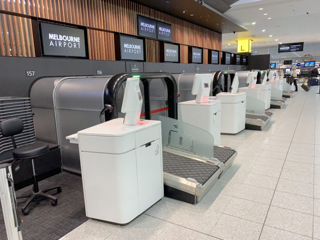 A line of self-serve bag-drop systems at the Melbourne Airport