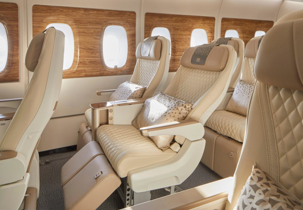 Emirates' new premium economy seat, with cream covers, a side view.