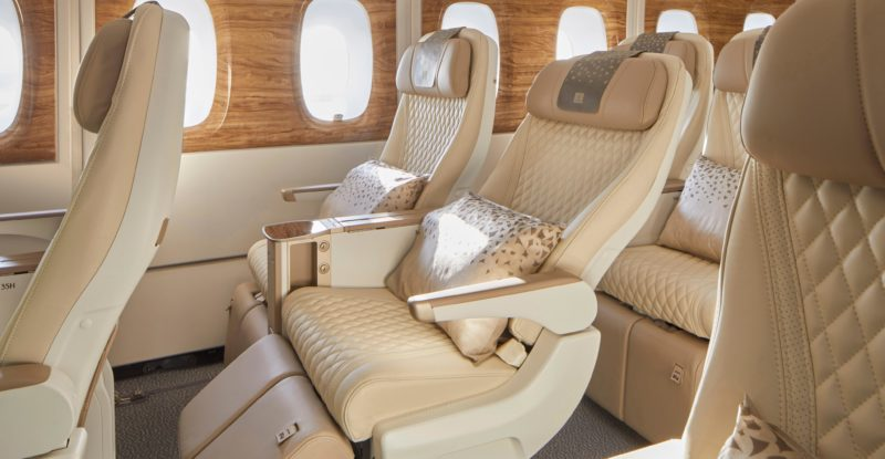 Emirates' new premium economy seat, with cream covers. The photo shows the new calfrest for passengers