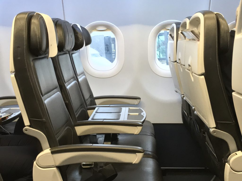 BA Club Europe seat triple, showing the table in the middle seat, separating aisle and window passengers