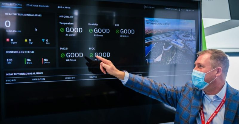 John Isherwood of Honeywell provides a demonstration of the airport air quality dashboard inside PIT's xBridge innovation center. (Photo by Beth Hollerich)