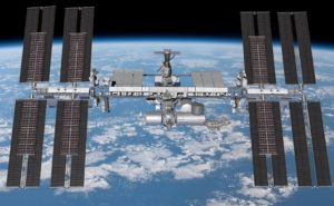 An artist's concept shows the International Space Station with new arrays in place.