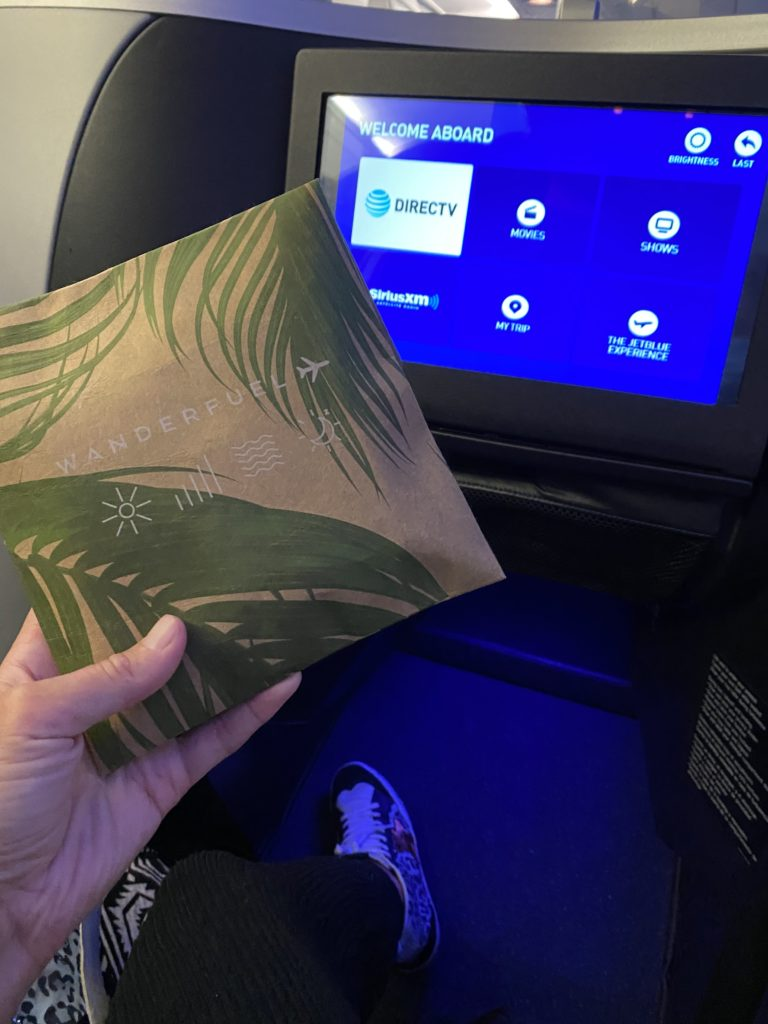 A close-up of the new amenity kit, with the in-seat IFE screen in the background