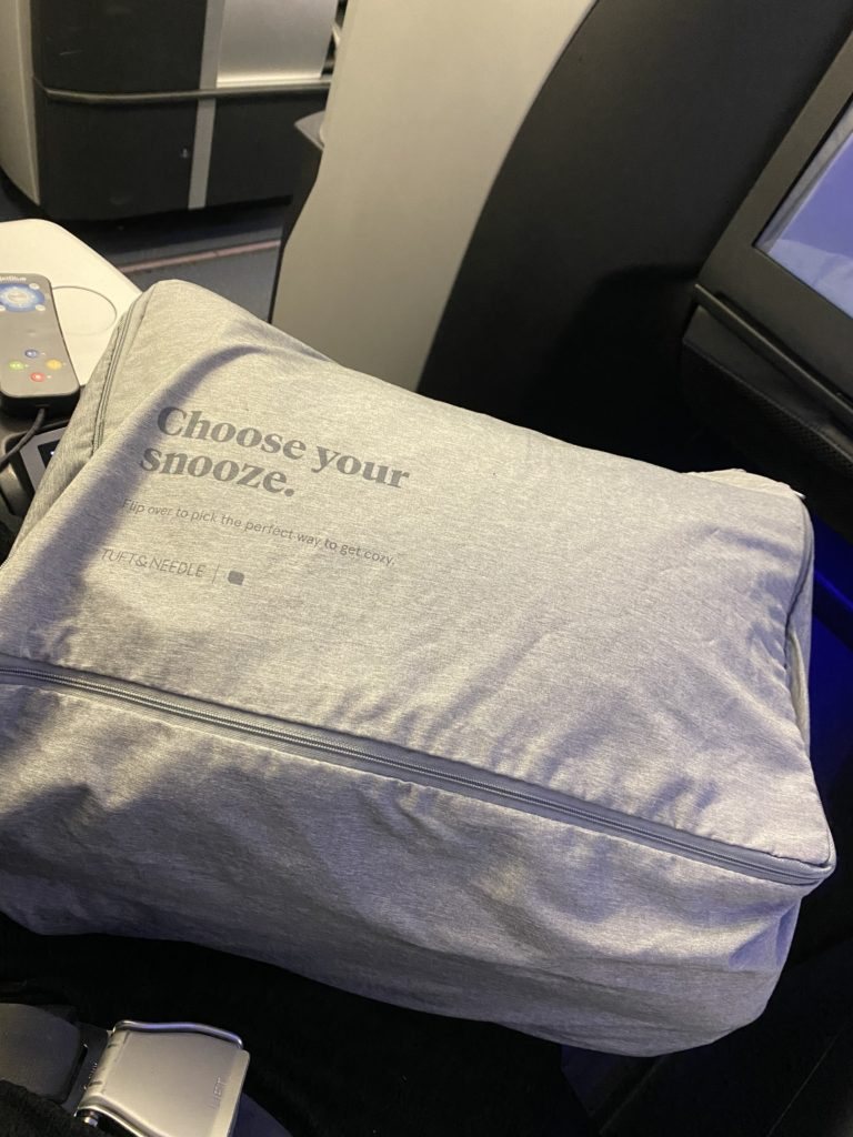 """A close up of the bedding bag, which reads: """"Choose our snooze"""""""