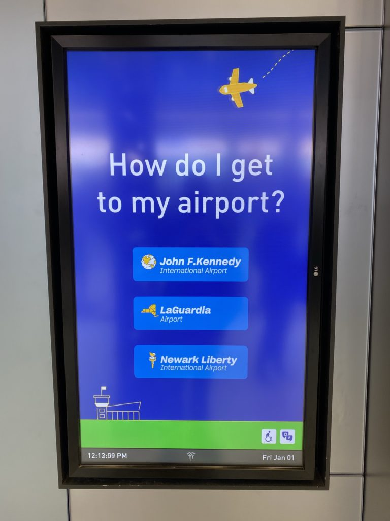 Signage telling passengers how to get to New York's three area airports