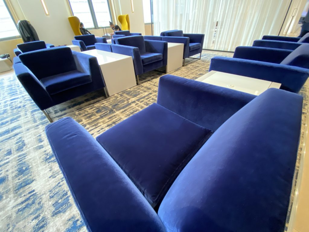Blue velvet covered seats in the new lounge