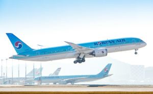 Korean Air Boeing 787-9 taking off with clear blue sky and another aircraft in the background