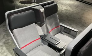 The original 2018 Air Rest didn't feature three-point belts (or, here at the annual AIX show that same year, any belts). Image shows Air Rest on the show floor, covered in grey fabric