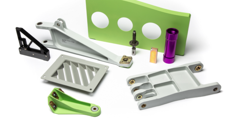 A selection of ATS PMA partsin silver, purple, green and black, displayed on a white backdrop
