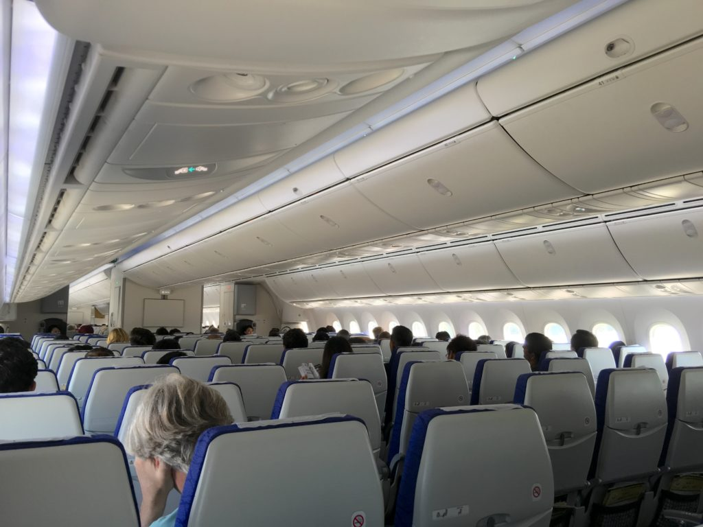Rows of seats aboard a Scoot 787 widebody, with overhead bins in sight