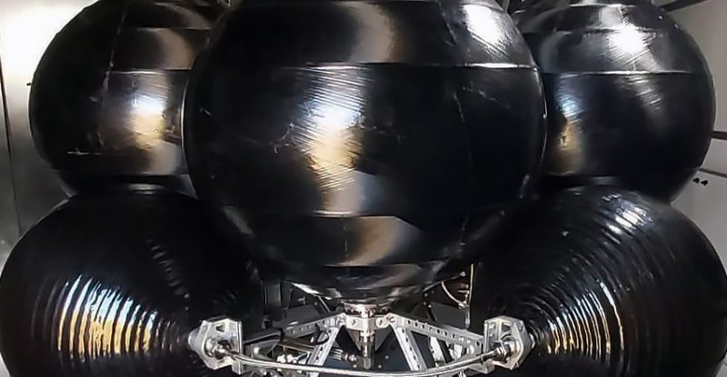 Skyrora XL launch vehicle which looks like 5 large black circular objects connected together by a series of bars.