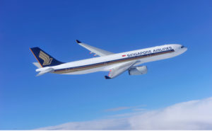 Singapore airlines A330-300 inflight in a clear blue sky.