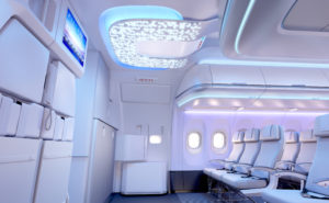 The entrance to an A320, with the airframer's signature Airspace cabin, including LED lights and projected designs on the ceiling