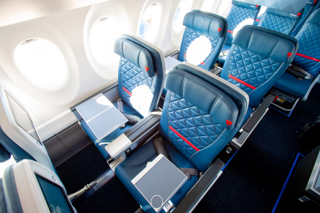 The Collins MiQ seat as seen in domestic first class on Delta, with the carrier's signature blue seat covers and stitching