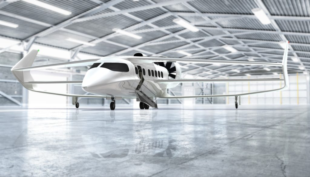 The BEHA looks dramatic, with its triplane wing and substantial endplate fins. A computer-generated rendering of the aircraft, in all-white livery, is shown inside a sparkling white hangar.