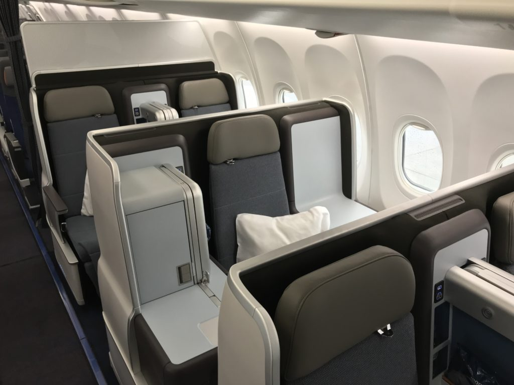 The full-flat seats aboard flydubai's 737 MAX aircraft are covered in a greyish material, and can extend fully flat. Shown here in the takeoff and landing seated position