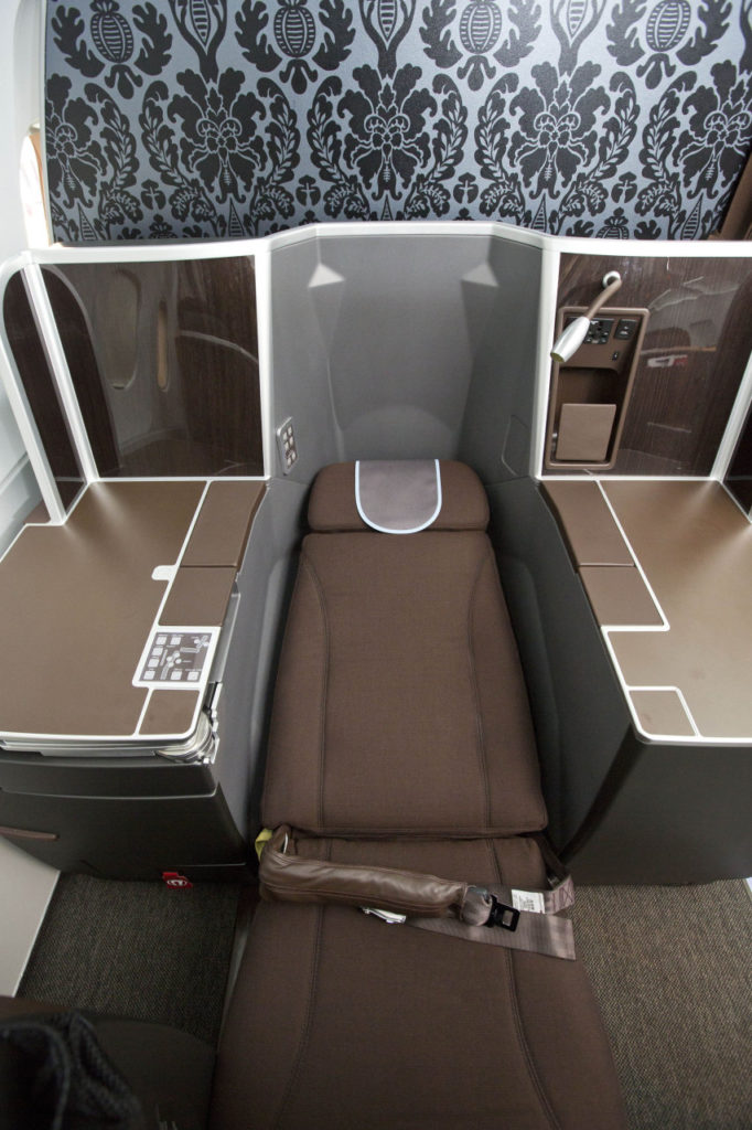 Light and dark browns decorate this Vantage seat for BA. An airbag seatbelt is seen in the picture.