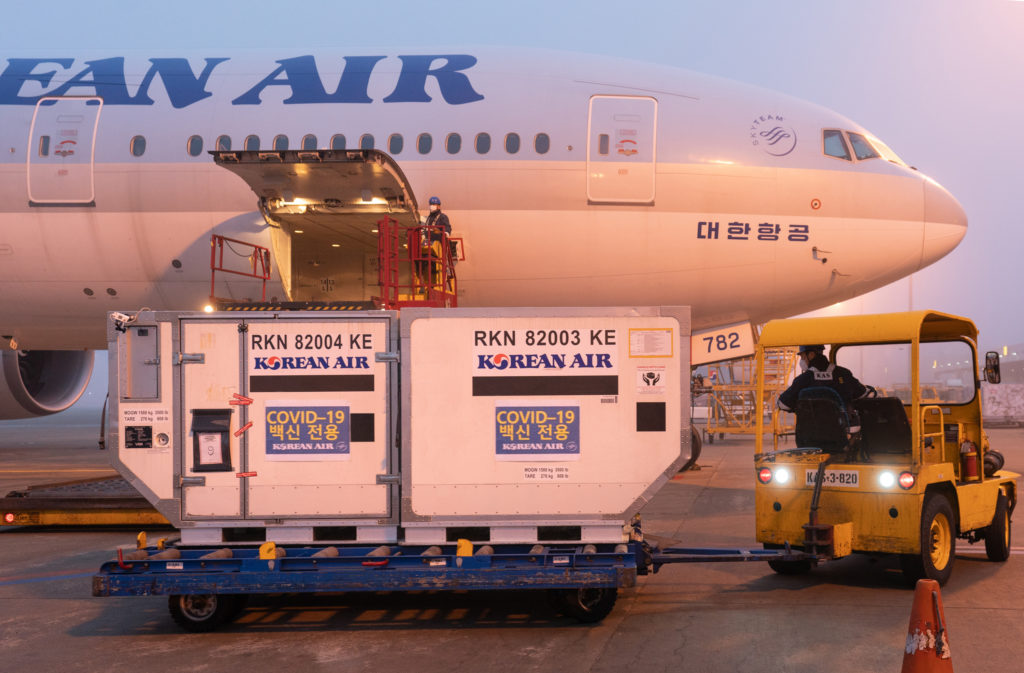 Korean Air Cargo vaccine transport aircraft on tarmac being loaded.