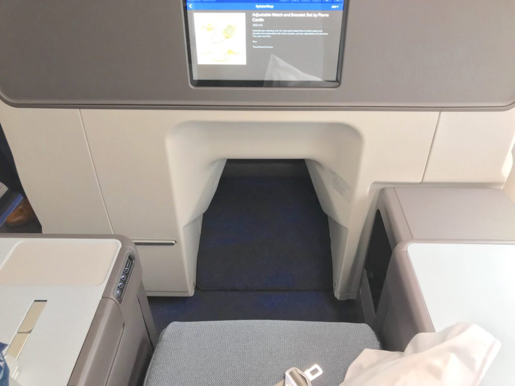 A tapered foot cubbie on a premium seat