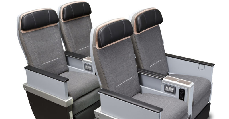 Collins' MiQ seats with greyish seat covers and black headrests