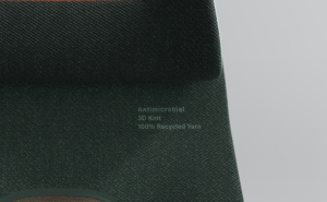 Close-up of a dark green seat cover with the word Antimicrobial printed on it