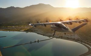 digital rendering of Archer's electric vertical takeoff and landing aircraft over a lake at sunset.