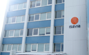 Grey building with blue pannels and the Isavia name an logo on the wall.