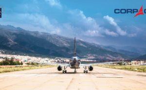 Aircraft heading down a runway towads a mountain view
