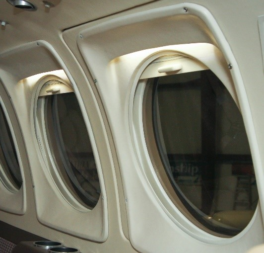 LED Lighting over large Aircraft Windows