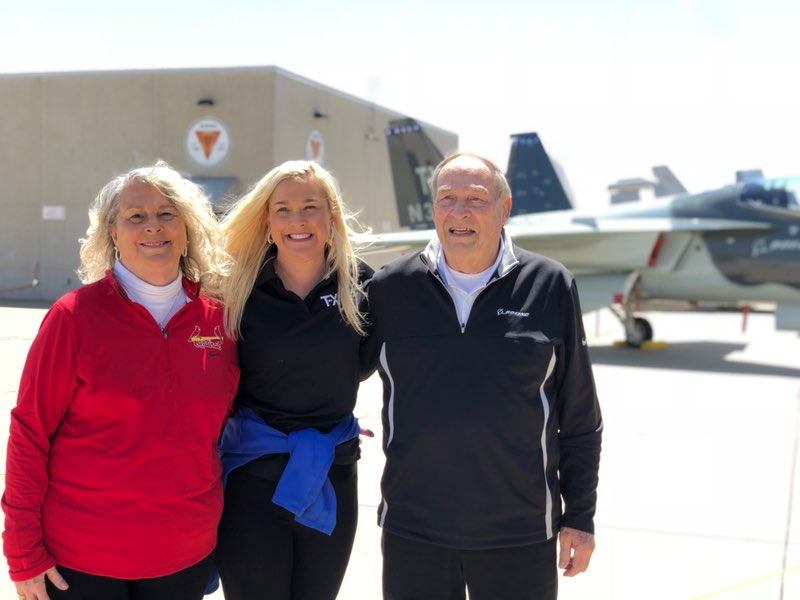 Sherri standing alongside her parents with one of the T-X aircraft
