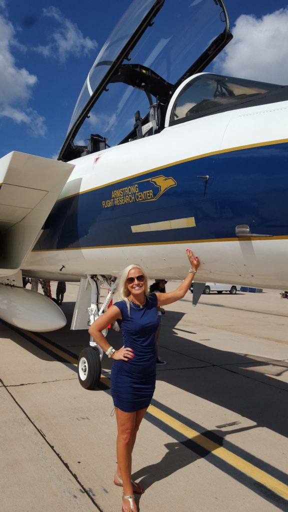 Sherri in front of the NASA F-5 during an airshow.