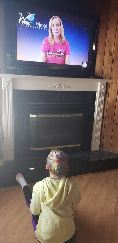 Lyrik, sitting on the floor of her living room watching host Allison McKay start off the program