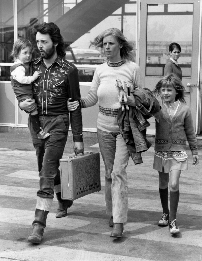 12th May 1971: Paul McCartney, singer, songwriter and bass player for the recently disbanded Beatles, with his wife Linda (1941 - 1998) and their two children, Mary (left) and Heather (right) at Gatwick Airport. Image: Central Press/Getty Images