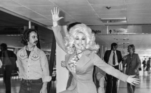 Country and Western singer Dolly Parton leaving Heathrow Airport after her popular appearance at The Country and Western music festival at Wembley.
