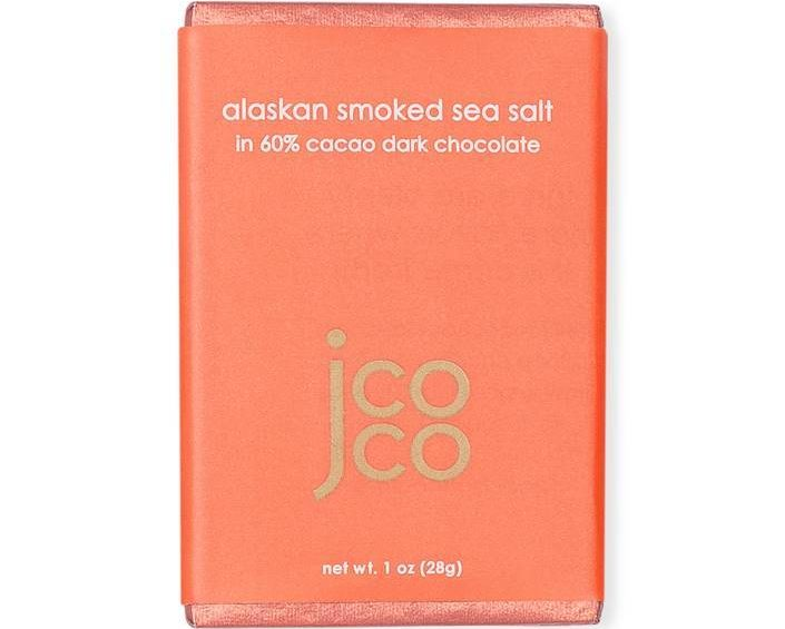 Alaska Smoked Sea Salt chocolate bar wrapped in salmon pink paper with Jcoco logo in gold.