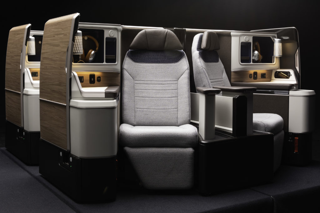 A front view of Ascent, with a black background. The seat is very modern and elegant, such as you might find in automotive design