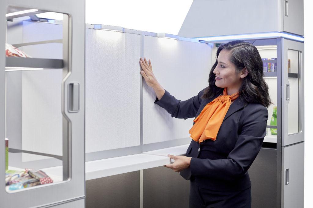 Flight attendant demonstrating parts of the M-Flex design.
