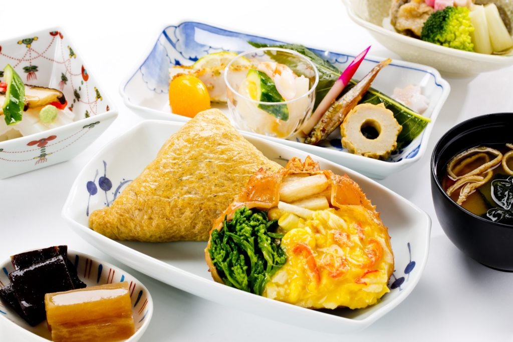 Different parts of an ANA inflight meal displayed in decorative dishes.