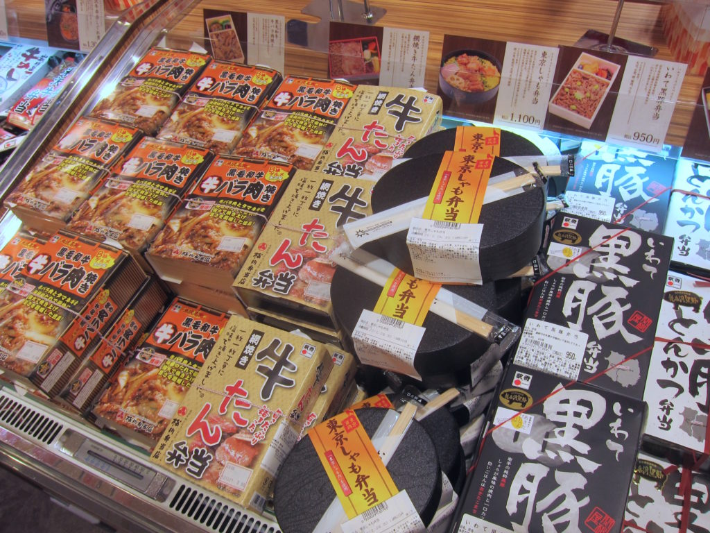 Bento boxes stacked in a display window