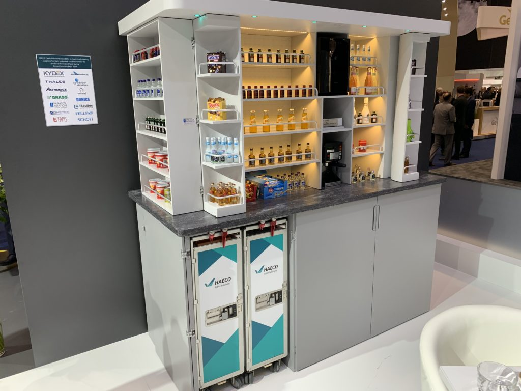 A food and beverage storage display for aircraft, as showcased by HAECO at an interiors exhibition.