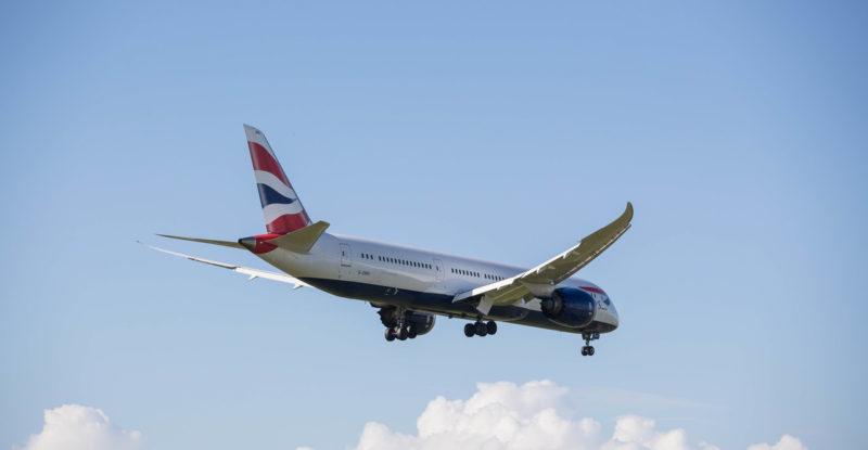 British Airways 787 with landing gear out in a clear blue sky