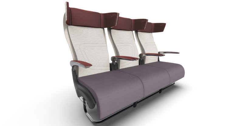 Paradym seat shown with a cream seatback and grey bottom with a brown headrest and armrests. The seat is wide, some three inches wider than 737 seats