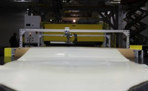 A sheet of thermoplastic comes off the line at Sekisui Kydex