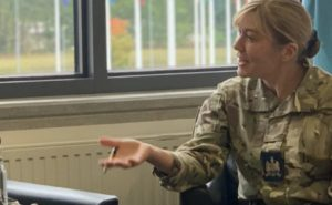 RAF Warrant Officer Sara Catterall chats with another service member