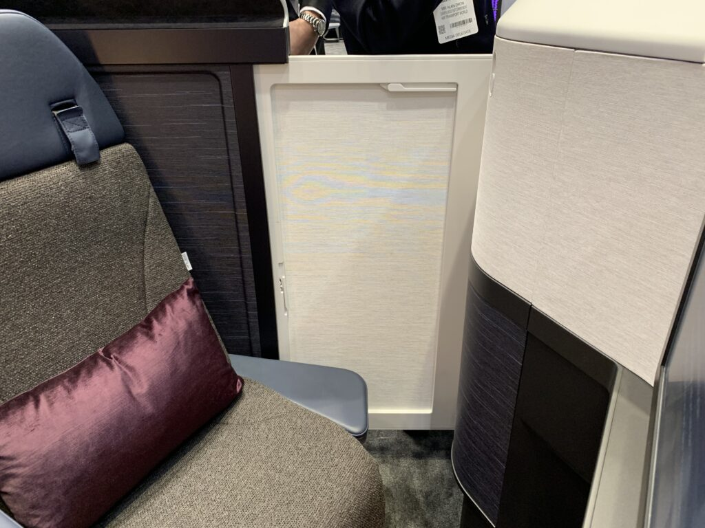 BA's Club Suite in blues, greys and purples. Showing the suite door, in cream, closed.