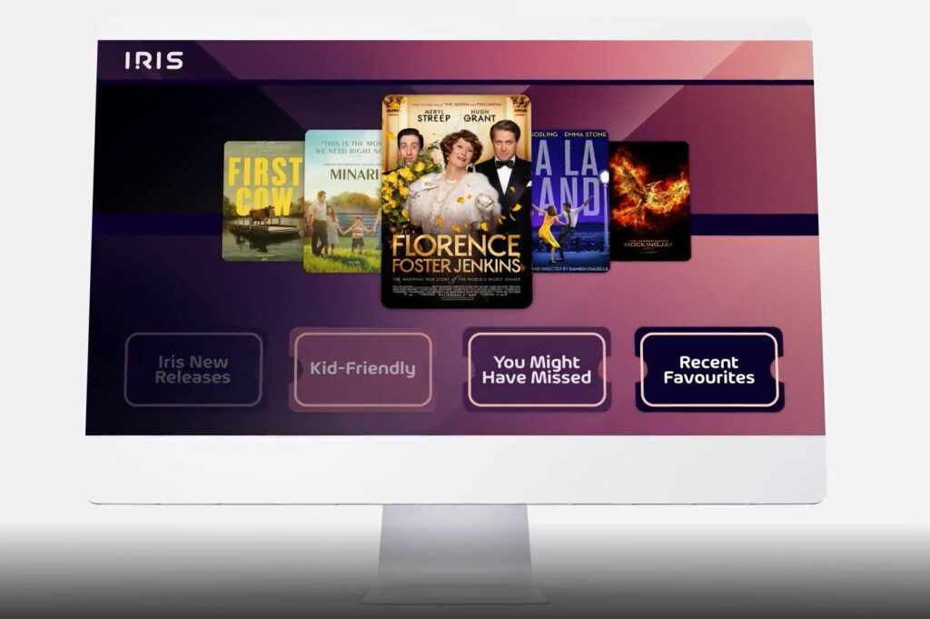 A screen showing different movie selections offered with the Iris platform. The backdrop is a variety of pinks/purples.